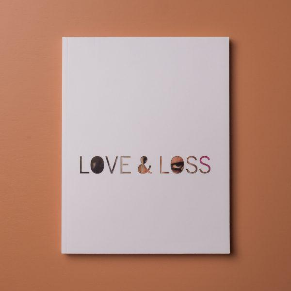 "Love <span class=""amp"">&</span>Loss"